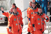 Space Shuttle Atlantis Commander Ken Ham (R-L), Mission Speicalists Michael Good and Piers Sellers, Pilot Tony Antonelli, Mission Specialists Steve Bowen and Garrett Reisman walk out of NASA's operations and checkout building and into the astronaut van at Kennedy Space Center May 14, 2010 in Cape Canaveral in preparation for their launch later today. This is scheduled to be the final launch for Atlantis.