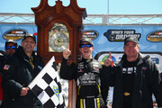 John H. Nemechek, driver of the #8 Fleetwing Chevrolet, crew chief Gere Kennon and his father Joe Nemechek, celebrate with the trophy in Victory Lane after winning the weather delayed NASCAR Camping World Truck Series Alpha Energy Solutions 250 at Martinsville Speedway on March 26, 2018 in Martinsville, Virginia.