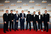 (L-R)  Kyle Busch, Joey Logano, Brad Keslowski, Donald Trump, Chase Elliott and Matt Crafton, Darrell Wallace Jr. and Ben Kennedy pose for a photo during the NASCAR Nationwide Series and NASCAR Camping World Truck Series Banquet at Trump National Doral on November 17, 2014 in Doral, Florida.