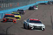 Kyle Busch, driver of the #18 Sport Clips Toyota, leads a pack of cars during the NASCAR Cup Series FanShield 500 at Phoenix Raceway on March 08, 2020 in Avondale, Arizona.