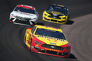 Joey Logano, driver of the #22 Shell Pennzoil Ford, leads Kyle Busch, driver of the #18 Sport Clips Toyota, and Brad Keselowski, driver of the #2 Alliance Parts Ford, and during the NASCAR Cup Series FanShield 500 at Phoenix Raceway on March 08, 2020 in Avondale, Arizona.