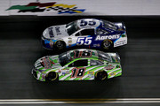 Kyle Busch, driver of the #18 Interstate Batteries Toyota, races David Ragan, driver of the #55 Aaron's Dream Machine Toyota, during the NASCAR Sprint Cup Series Coke Zero 400 Powered by Coca-Cola at Daytona International Speedway on July 6, 2015 in Daytona Beach, Florida.
