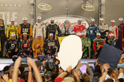 (Back row L-R) Matt Kenseth, driver of the #20 Dollar General Toyota, Ryan Newman, driver of the #31 Caterpillar Chevrolet, Carl Edwards, driver of the #19 ARRIS Toyota, Paul Menard, driver of the #27 Libman/Menards Chevrolet, Kevin Harvick, driver of the #4 Budweiser/Jimmy John's Chevrolet, Dale Earnhardt Jr., driver of the #88 Nationwide Chevrolet, Brad Keselowski, driver of the #2 Miller Lite Ford, Jeff Gordon, driver of the #24 3M Chevrolet, Denny Hamlin, driver of the #11 FedEx Express Toyota, (front row L-R) Jamie McMurray, driver of the #1 Cessna Chevrolet, Kurt Busch, driver of the #41 Haas Automation Chevrolet, Joey Logano, driver of the #22 Shell Pennzoil Ford, Martin Truex Jr., driver of the #78 Furniture Row/Visser Precision Chevrolet, Kyle Busch, driver of the #18 M&M's Crispy/American Heritage Chocolate Toyota, Clint Bowyer, driver of the #15 5-hour Energy Toyota, and Jimmie Johnson, driver of the #48 Lowe's Chevrolet,  pose for a photo after making the Chase for the Sprint Cup after the NASCAR Sprint Cup Series Federated Auto Parts 400 at Richmond International Raceway on September 12, 2015 in Richmond, Virginia.