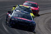 Austin Dillon, driver of the #3 Dow Chevrolet, leads Matt Kenseth, driver of the #20 Dollar General Toyota, and Dale Earnhardt Jr, driver of the #88 Axalta Chevrolet, during the NASCAR Sprint Cup Series Good Sam 500 at Phoenix International Raceway on March 13, 2016 in Avondale, Arizona.
