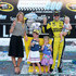 Katie Kenseth Photos - Matt Kenseth, driver of the #20 Dollar General Toyota, poses in victory lane with his wife Katie and daughters Kaylin, Grace, and Clara after winning  the NASCAR Sprint Cup Series Pure Michigan 400 at Michigan International Speedway on August 16, 2015 in Brooklyn, Michigan. - NASCAR Sprint Cup Series Pure Michigan 400