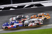 Brian Scott, driver of the #2 Shore Lodge Chevrolet, leads Joey Logano, driver of the #22 Discount Tire Ford, Ty Dillon, driver of the #3 Yuengling America's Oldest Brewery Chevrolet, and Daniel Suarez, driver of the #18 ARRIS Toyota, during the NASCAR XFINITY Series Subway Firecracker 250 Powered By Coca-Cola at Daytona International Speedway on July 4, 2015 in Daytona Beach, Florida.