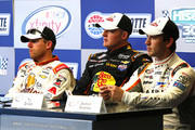 (L-R) Regan Smith, driver of the #7 Anderson's Pure Maple Syrup Chevrolet, Ty Dillon, driver of the #3 Bass Pro Shops/NWTF.org Chevrolet, and Daniel Suarez, driver of the #18 ARRIS Toyota, speak to the media during a press conference after the NASCAR XFINITY Series Hisense 300 at Charlotte Motor Speedway on May 23, 2015 in Charlotte, North Carolina.