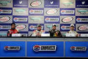 (L-R) Darrell Wallace Jr., driver of the #6 Cheez-It Ford, Regan Smith, driver of the #7 Anderson's Pure Maple Syrup Chevrolet, Ty Dillon, driver of the #3 Bass Pro Shops/NWTF.org Chevrolet, and Daniel Suarez, driver of the #18 ARRIS Toyota, speak to the media during a press conference after the NASCAR XFINITY Series Hisense 300 at Charlotte Motor Speedway on May 23, 2015 in Charlotte, North Carolina.