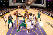 Rajon Rondo #9 of the Boston Celtics goes to the basket against Pau Gasol #16 and Kobe Bryant #24 of the Los Angeles Lakers in Game Two of the 2010 NBA Finals at Staples Center on June 6, 2010 in Los Angeles, California.