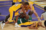 Kevin Garnett #5 of the Boston Celtics tries to hold on to the ball under pressure from Kobe Bryant #24, Derek Fisher #2 and Pau Gasol #16 of the Los Angeles Lakers in the first half of Game Six of the 2010 NBA Finals at Staples Center on June 15, 2010 in Los Angeles, California.  NOTE TO USER: User expressly acknowledges and agrees that, by downloading and/or using this Photograph, user is consenting to the terms and conditions of the Getty Images License Agreement.