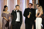 """In this handout photo provided by NBCUniversal Media, LLC,  David Heyman accepts the award for BEST MOTION PICTURE – MUSICAL OR COMEDY for """"Once Upon a Time...in Hollywood"""" onstage, with Shannon McIntosh, Quentin Tarantino, Golden Globe Ambassador Paris Brosnan and Margot Robbie, during the 77th Annual Golden Globe Awards at The Beverly Hilton Hotel on January 5, 2020 in Beverly Hills, California."""