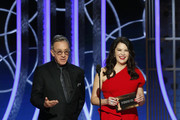 In this handout photo provided by NBCUniversal Media, LLC,  Tim Allen and Lauren Graham  speak onstage during the 76th Annual Golden Globe Awards at The Beverly Hilton Hotel on January 5, 2020 in Beverly Hills, California.