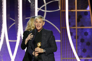 In this handout photo provided by NBCUniversal Media, LLC,  Ellen DeGeneres accepts the CAROL BURNETT AWARD presented by Kate McKinnon onstage during the 76th Annual Golden Globe Awards at The Beverly Hilton Hotel on January 5, 2020 in Beverly Hills, California.