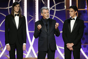 In this handout photo provided by NBCUniversal Media, LLC,  Golden Globe Ambassador Dylan Brosnan, father and actor Pierce Brosnan and Golden Globe Ambassador Paris Brosnan speak onstage during the 76th Annual Golden Globe Awards at The Beverly Hilton Hotel on January 5, 2020 in Beverly Hills, California.