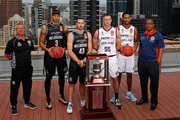 Coach Dean Vickerman, Josh Boone and Chris Goulding of Melbourne United along with Mitch Creek,  Josh Childress and coach Joey Wright of the Adelaide 36ers pose with the Dr John Raschke Trophy during the NBL Grand Final media opportunity at 333 Collins St on March 15, 2018 in Melbourne, Australia.