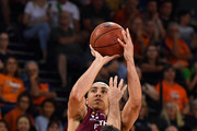 Travis Trice of the Bullets takes a jump shot over Jarrad Weeks of the Taipans during the round 13 NBL match between the Cairns Taipans and the Brisbane Bullets at the Cairns Convention Centre on January 5, 2018 in Cairns, Austra