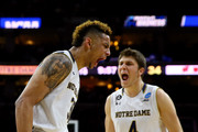 Zach Auguste #30 of the Notre Dame Fighting Irish celebrates with teammate Matt Ryan #4 after a basket in the second half against the Wisconsin Badgers during the 2016 NCAA Men's Basketball Tournament East Regional at Wells Fargo Center on March 25, 2016 in Philadelphia, Pennsylvania.