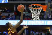 A.J. English #5 of the Iona Gaels makes a layup against the Iowa State Cyclones during the first round of the 2016 NCAA Men's Basketball Tournament at the Pepsi Center on March 17, 2016 in Denver, Colorado.