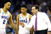 Head coach Mike Krzyzewski of the Duke Blue Devils speaks with Gary Trent Jr. #2 and Trevon Duval #1 during a timeout against the Syracuse Orange during the second half in the 2018 NCAA Men's Basketball Tournament Midwest Regional at CenturyLink Center on March 23, 2018 in Omaha, Nebraska. The Duke Blue Devils defeated the Syracuse Orange 69-65.