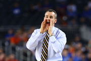 Head coach Billy Donovan of the Florida Gators yells to his team in the first half against the Florida Gulf Coast Eagles during the South Regional Semifinal round of the 2013 NCAA Men's Basketball Tournament at Dallas Cowboys Stadium on March 29, 2013 in Arlington, Texas.