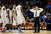 The Florida Gators huddle during a timeout against the Dayton Flyers during the south regional final of the 2014 NCAA Men's Basketball Tournament at the FedExForum on March 29, 2014 in Memphis, Tennessee.