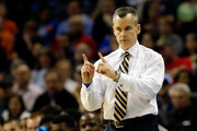 Head coach Billy Donovan of the Florida Gators motions to his players during the south regional final of the 2014 NCAA Men's Basketball Tournament against the Dayton Flyers at the FedExForum on March 29, 2014 in Memphis, Tennessee.