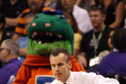 Head coach Billy Donovan of the Florida Gators kneels in front of the bench in the first half against the Louisville Cardinals during the 2012 NCAA Men's Basketball West Regional Final at US Airways Center on March 24, 2012 in Phoenix, Arizona.