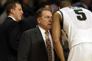 Head coach Tom Izzo of the Michigan State Spartans talks with Adreian Payne #5 against the Valparaiso Crusaders during the second round of the 2013 NCAA Men's Basketball Tournament at at The Palace of Auburn Hills on March 21, 2013 in Auburn Hills, Michigan.
