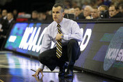 Head coach Billy Donovan of the Florida Gators looks on against the Virginia Cavaliers during the second round of the 2012 NCAA Men's Basketball Tournament at CenturyLink Center on March 16, 2012 in Omaha, Nebraska.