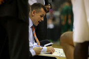 Head coach Billy Donovan of the Florida Gators talks with his players at a timeout in the first half against the Norfolk State Spartans during the third round of the 2012 NCAA Men's Basketball Tournament at CenturyLink Center on March 18, 2012 in Omaha, Nebraska.