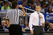 Head coach Billy Donovan of the Florida Gators reacts in the first half while looking at the referee as the Gators are taking on the Pittsburgh Panthers during the third round of the 2014 NCAA Men's Basketball Tournament at Amway Center on March 22, 2014 in Orlando, Florida.