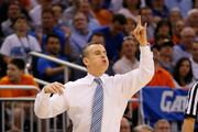 Head coach Billy Donovan of the Florida Gators calls a play while taking on the Pittsburgh Panthers during the third round of the 2014 NCAA Men's Basketball Tournament at Amway Center on March 22, 2014 in Orlando, Florida.