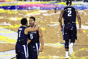 Jalen Brunson #1 and Phil Booth #5 of the Villanova Wildcats celebrate defeating the North Carolina Tar Heels 77-74 to win the 2016 NCAA Men's Final Four National Championship game at NRG Stadium on April 4, 2016 in Houston, Texas.