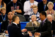 Head coach Billy Donovan of the Florida Gators (L) and head coach Kevin Ollie of the Connecticut Huskies (R) meet before the NCAA Men's Final Four Semifinal at AT&T Stadium on April 5, 2014 in Arlington, Texas.
