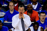 Head coach Billy Donovan of the Florida Gators calls to his players during the NCAA Men's Final Four Semifinal against the Connecticut Huskies at AT&T Stadium on April 5, 2014 in Arlington, Texas.