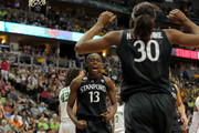 Chiney Ogwumike #13 and Nnemkadi Ogwumike #30 of the Stanford Cardinal celebrate after Nnemkadi was fouled in the second half by Brittney Griner #42 of the Baylor Bears during the National Semifinal game of the 2012 NCAA Division I Women's Basketball Championship at Pepsi Center on April 1, 2012 in Denver, Colorado.
