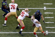 Quarterback Colin Kaepernick #7 of the San Francisco 49ers carries the ball against the Seattle Seahawks during the 2014 NFC Championship at CenturyLink Field on January 19, 2014 in Seattle, Washington.