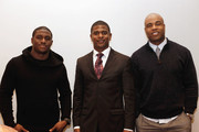 (L-R) Reggie Bush of the Miami Dolphins, Jack Brewer and former NFL player Akin Ayodele pose for the photo during the media day at Kerry Hotel on February 1, 2013 in Beijing, China.