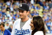 Ashton Kutcher and wife Mila Kunis annouce the Los Angeles Dodgers starting lineup before game four of the National League Championship Series against the Chicago Cubs at Dodger Stadium on October 19, 2016 in Los Angeles, California.