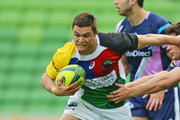Michael Adams of the Rays runs with the ball during the round one National Rugby Championship match between Melbourne Rising and the North Harbour Rays at AAMI Park on August 24, 2014 in Melbourne, Australia.