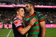 Cooper Cronk of the Roosters talks to Greg Inglis of the Rabbitohs following the NRL Preliminary Final match between the Sydney Roosters and the South Sydney Rabbitohs at Allianz Stadium on September 22, 2018 in Sydney, Australia.
