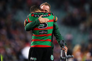 Greg Inglis and Jason Clark of the Rabbitohs embraces after defeat during the NRL Preliminary Final match between the Sydney Roosters and the South Sydney Rabbitohs at Allianz Stadium on September 22, 2018 in Sydney, Australia.