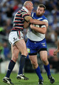 Craig Fitzgibbon of the Roosters tackles Jarrad Hickey of the Bulldogs during the round 24 NRL match between the Bulldogs and the Sydney Roosters at ANZ Stadium on August 24, 2009 in Sydney, Australia.