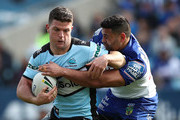 Chad Townsend of the Sharks is tackled  during the round 25 NRL match between the Canterbury Bulldogs and the Cronulla Sharks at ANZ Stadium on September 2, 2018 in Sydney, Australia.