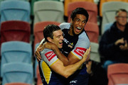 Ashley Graham of the Cowboys celebrates with Will Tupou after scoring a try during the round three NRL match between the North Queensland Cowboys and the Melbourne Storm at Dairy Farmers Stadium on March 28, 2011 in Townsville, Australia.