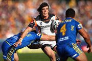 Joel Reddy of the Tigers is tackled during the round eight NRL match between the Parramatta Eels and the Wests Tigers at Parramatta Stadium on April 29, 2012 in Sydney, Australia.