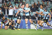 Chad Townsend of the Sharks celebrates with his team mates after scoring a try during the NRL Semi Final match between the Cronulla Sharks and the Penrith Panthers at Allianz Stadium on September 14, 2018 in Sydney, Australia.