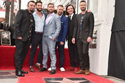 (L-R) Members of the iconic 90's boyband *NSYNC, Chris Kirkpatrick, Lance Bass, JC Chasez, Joey Fatone and Justin Timberlake (along with Lance Bass' husband, Michael Turchin, second from left) were honored with a star on the Hollywood Walk of Fame on April 30, 2018 in Hollywood, California.