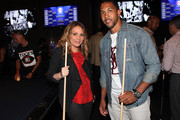 (L-R) Angie Martinez and Terrell Thomas attend the NY Giants Justin Tuck 4th Annual celebrity billiards tournament at Slate NYC on May 31, 2012 in New York City.