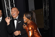 Joe Zee (L) and June Ambrose pose backstage at Naomi Campbell's Fashion For Relief Charity Fashion Show during Mercedes-Benz Fashion Week Fall 2015 at The Theatre at Lincoln Center on February 14, 2015 in New York City.